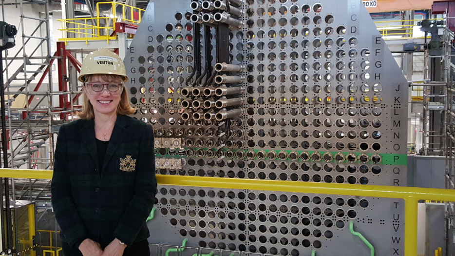 Chalmers new DOMB, Moyra McDill, Professor Emeritus  from Carleton University (Ottawa, Canada) and outgoing Commissioner of the Canadian Nuclear Safety Commission standing in front of the full-scale reactor mock-up developed by Ontario Power Generation for the purposes of training for refurbishment of four CANDU reactors at the Darlington Nuclear Generating Station.